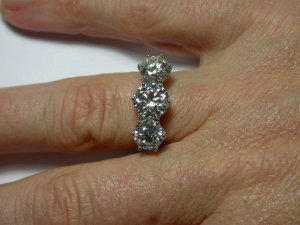 Show me three stone settings with larger side diamonds PriceScope