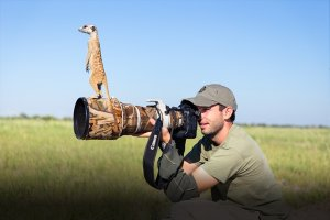 will_burrard-lucas_and_meerkat_looking_for_something_worth_photographing.jpg