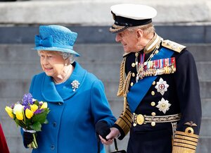 The Queen and Prince Philip hold hands as they leave St Paul's Cathedral in March 2015 in London.jpg
