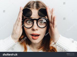 stock-photo-cartoon-woman-with-round-glasses-with-huge-eyes-525739858.jpg