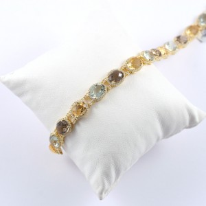 Multi color stone bracelet in yellow gold with diamonds