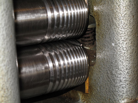 Platinum wire between rollers of a mill