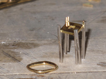 Prongs soldered to lower plate