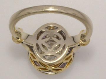 Finished diamond purple sapphire ring undergallery