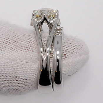Finished diamond engagement ring with wedding band