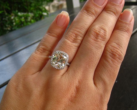 4 carat cushion cut diamond ring on hand