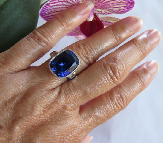 makeable's 9 Carat Cushion Cut Tanzanite Ring with Vintage Tapered French Cut Diamonds (Hand View) - image by makeable