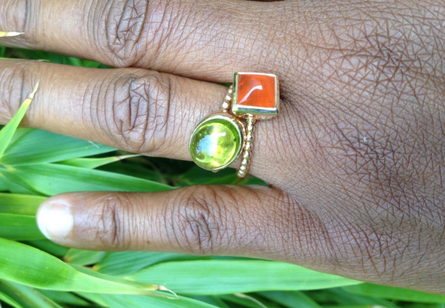 peridot and fire opal rings in gold - Image by Acinom