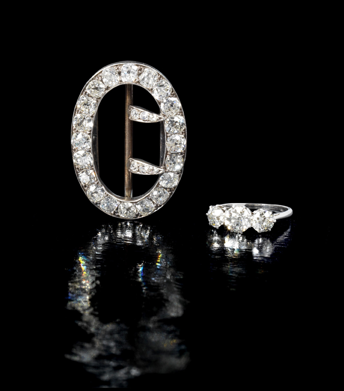 Agatha Christie's diamond brooch and 3-stone ring • Image: Bonhams