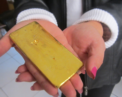 Fairmined gold bar held by AURELSA president Rosa Reyes