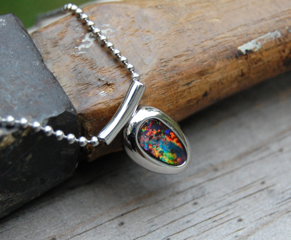 Man Pendant: Boulder Opal in White Gold