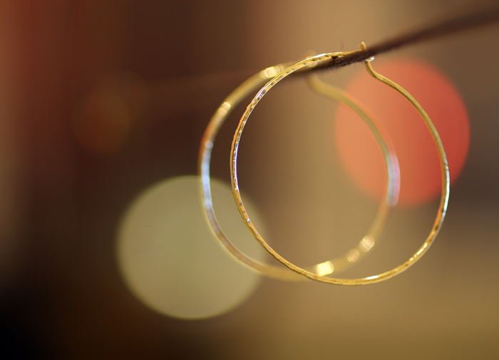 Gold hoop earrings - stock image by Erika Winters