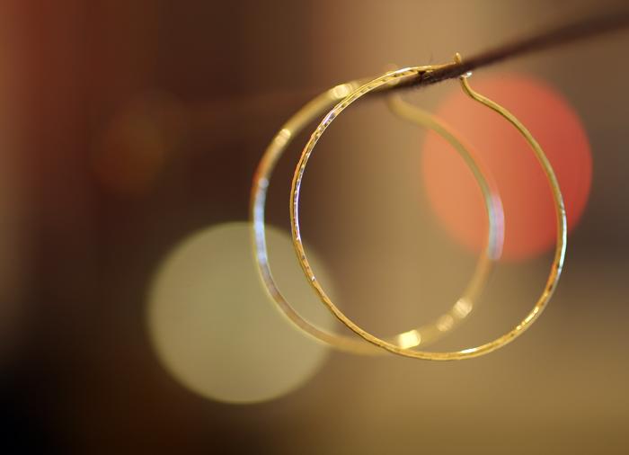Gold hoop earrings - stock image by Erika Winters