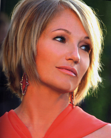 Ellen Barkin wearing JAR Imperial Topaz earrings at the 2005 Academy Awards