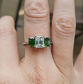LawmaLlama's Three Stone Emerald Cut Diamond and Tsavorite Ring  (Hand View) - image by LawmaLlama