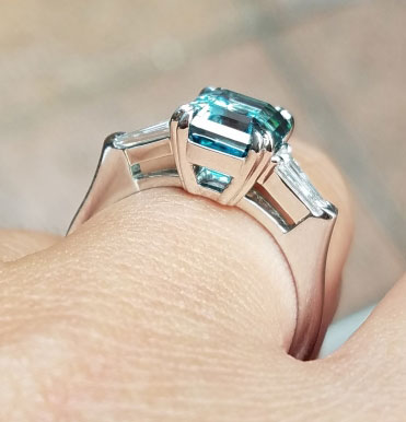 mochiko42's 3 Stone Emerald Cut Blue Zircon Ring (Side Angle View) - image from mochiko42
