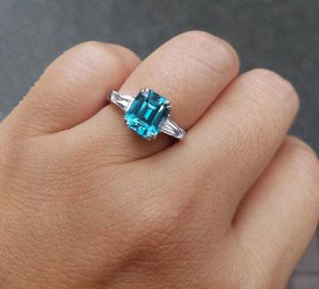 mochiko42's 3 Stone Emerald Cut Blue Zircon Ring (Hand View) - image from mochiko42