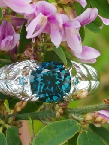 picante27's Platinum Teal Sapphire Peacock Ring (Flower View) - image by picante27