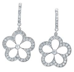 Diamond daisy drop earrings by Gumuchian