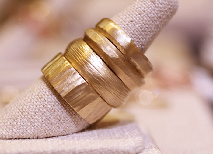 Textural gold wedding bands designed by Rebecca Overmann • Image Erika Winters