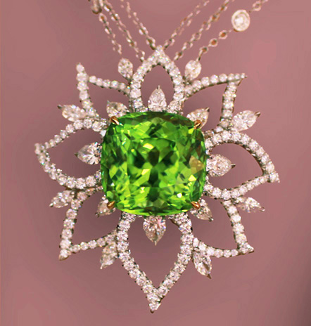 Richard Krementz platinum and 18K yellow prong-set pendant featuring a 33.58 ct. Peridot and Diamonds