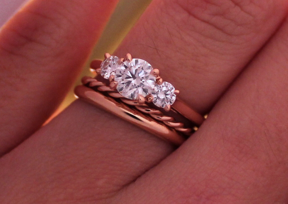 Rose gold 3-stone diamond ring with wedding bands