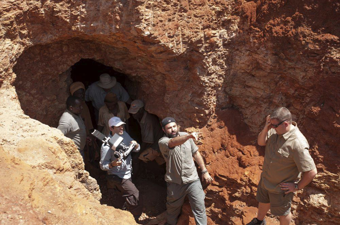 Miners, cast, and crew emerge from a mine. Image courtesy of Sharing the Rough.