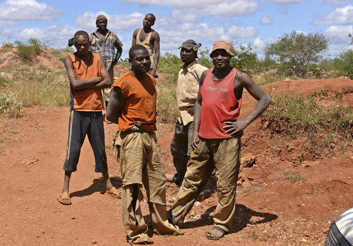 Gemstone miners take a moment to pose for a still from Sharing the Rough.