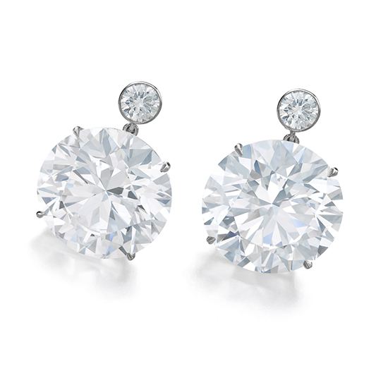 A pair of D-color, internally-flawless diamonds weighing 23.77 and 23.78 carats