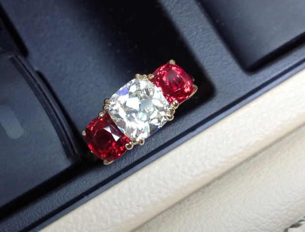 August Vintage Cushion diamond and red spinel 3-stone ring