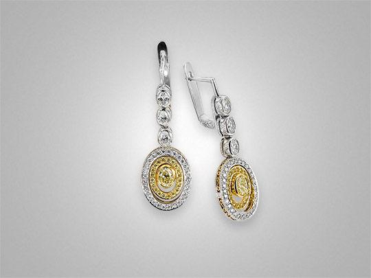 Victor Canera fancy yellow oval diamond earrings