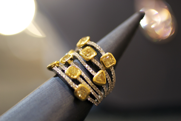 Yael Designs Ring with 3.66 carats of bezel-set fancy yellow diamonds