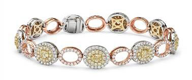 Yellow and White Diamond Oval Halo Bracelet in 18k White, Rose and Yellow Gold at Blue Nile