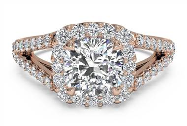 Cushion diamond set in a rose gold halo setting