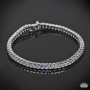 Half bezel diamond tennis bracelet with a 42 Cut Above diamond melee at Whiteflash