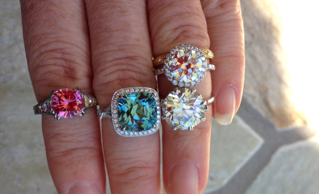 Aquamarine, tourmaline, and diamond rings - image by arkieb1