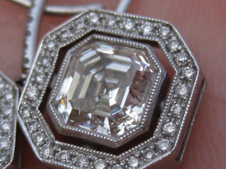 Asscher cut diamond halo earrings with millegrain