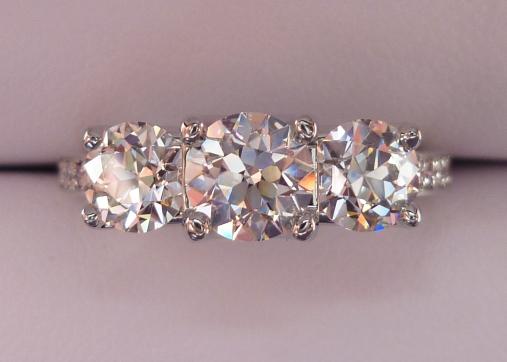 August Vintage Round Diamond Three-Stone Ring