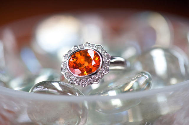 Custom engagement ring with spessartite garnet