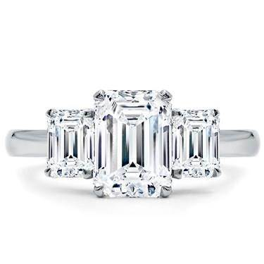 Emerald cut three stone engagement ring at Adiamor