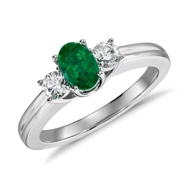 Petite emerald and diamond ring set in 18K white gold at Blue Nile