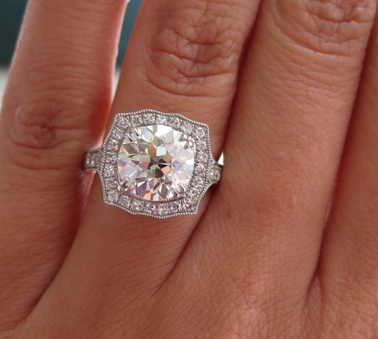 Halo diamond engagement ring shared by star sparkle