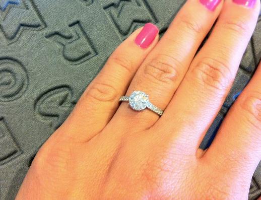 Custom diamond engagement ring on the hand