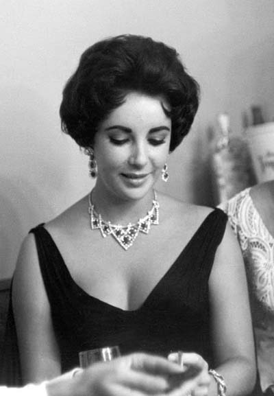 Elizabeth Taylor wearing Diamond and ruby Cartier suite