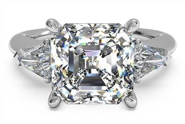 Three-stone engagement ring with bullet side diamonds set in platinum at Ritani