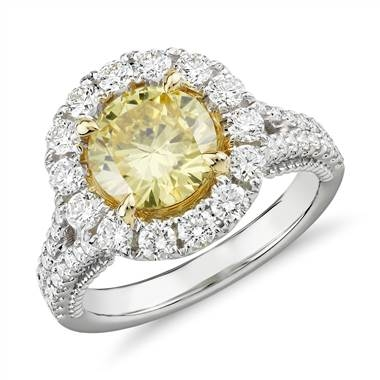 Fancy intense yellow diamond halo ring set in 18K white and yellow gold at Blue Nile