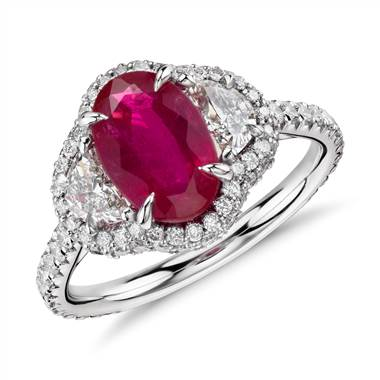 Ruby and half moon diamond halo ring set in platinum at Blue Nile