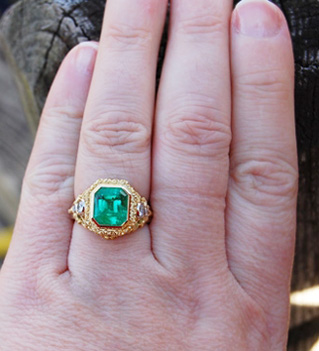 Emerald ring on the hand