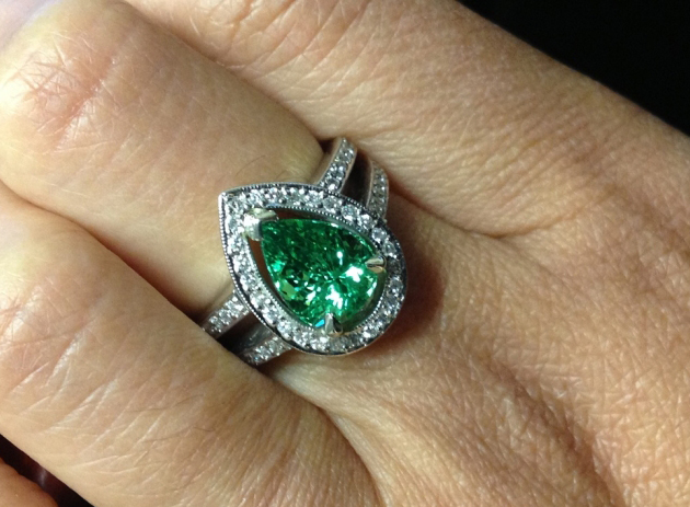 Halo diamond ring with green garnet