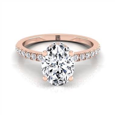Classic petite split prong oval diamond engagement ring set in 14K rose gold at RockHer
